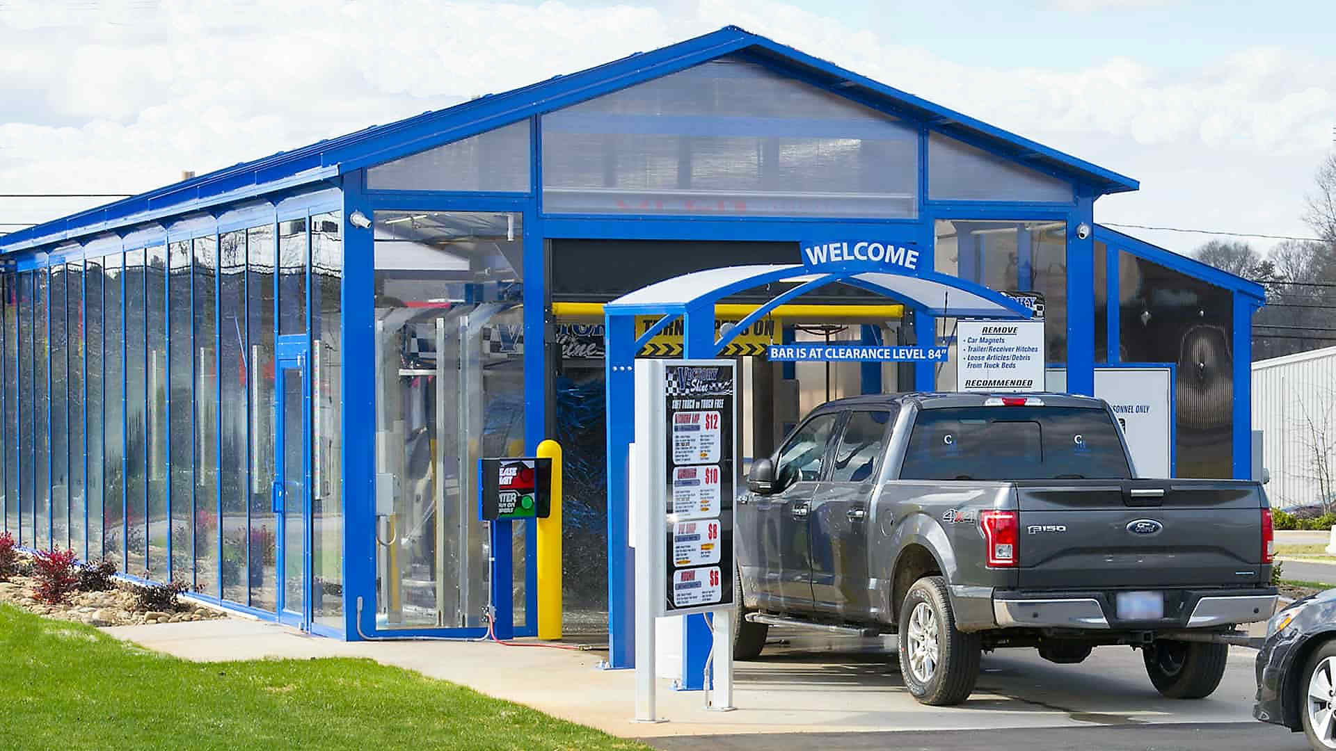 car wash building blue awning to match glass building color